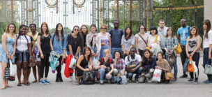 a group of international students posing in front of the parc